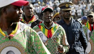 Mugabe flies in, jets out