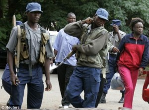 Zim group confirms arrest of two students after Mugabe protest
