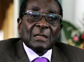 Mugabe feels heat on return