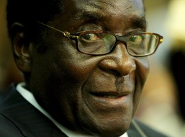 WATCH: Mugabe bows to own portrait