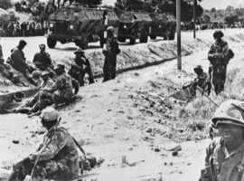 Government troops gather on a road west of Bulawayo, Zimbabwe, in February, 1981 to cut off any attempt by former guerrillas loyal to Joshua Nkomo to move into the city. Violence between factions loyal to Zimbabwe Prime Minister Robert Mugabe and Nkomo, his former partner in the guerrilla alliance against white minority rule, claimed the lives of an estimated 20,000 civilians between 1983 and 1984. (The Associated Press)