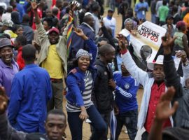 'Leave Zimbabwe now': thousands of protesters call for Robert Mugabe to go