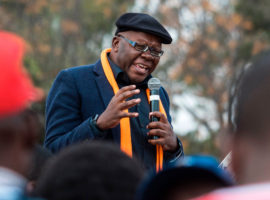 Zimbabwean opposition leader Tendai Biti of the Peoples democratic Party (PDP) addresses supporters gathered at a rally to launch the opposition parties' coalition to fight Zimbabwe long-time ruler Robert Mugabe in 2018 elections on August 5, 2017 in Harare.  Zimbabwean opposition parties launch a united alliance to take on Robert Mugabe's ZANU-PF party in 2018 elections on August 5, 2017 in Harare.  / AFP PHOTO / Jekesai NJIKIZANA        (Photo credit should read JEKESAI NJIKIZANA/AFP/Getty Images)